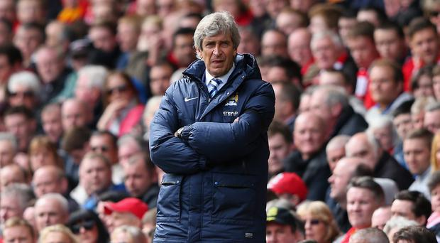 LIVERPOOL, ENGLAND - APRIL 13: Manchester City Manager Manuel Pellegrini looks on during the Barclays Premier League match between Liverpool and Manchester City at Anfield on April 13, 2014 in Liverpool, England. (Photo by Alex Livesey/Getty Images)