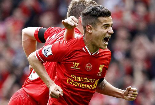 Liverpool's Phillippe Coutinho celebrates after he scores his teams winner
