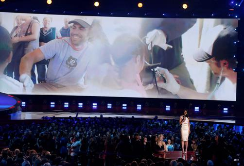 Actress Jordana Brewster introduces a tribute to Paul Walker at the 2014 MTV Movie Awards in Los Angeles, California April 13, 2014. REUTERS/Lucy Nicholson