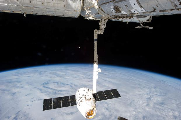 This file photo provided by NASA shows the release of the SpaceX Dragon-2 spacecraft from the International Space Station. Photo: AP Photo/NASA