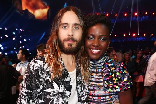 Actor Jared Leto (L) and actress Lupita Nyong'o attend the 2014 MTV Movie Awards