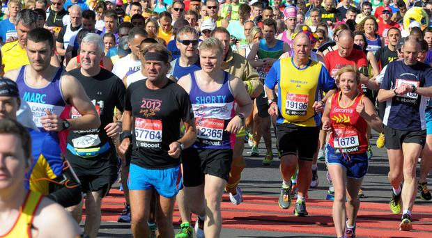 Runners at the start of the Virgin Money London Marathon yesterday