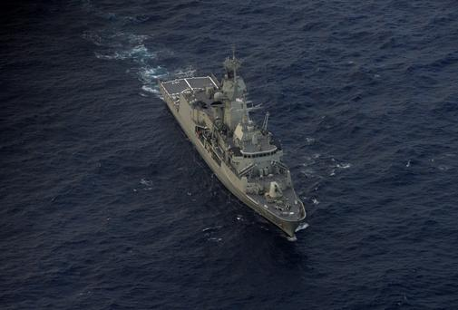 The Royal Australian Navy ship HMAS Perth helps in the search for the missing jet in the southern Indian Ocean. Photo: Getty Images