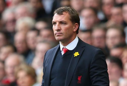 Liverpool manager Brendan Rodgers knows he's four wins from the title