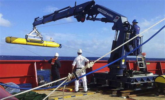 The Bluefin 21 is hoisted back on board the Australian Defence Vessel Ocean Shield after a successful buoyancy test in the southern Indian Ocean Photo: Reuters