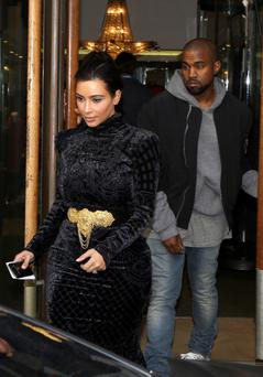 Kim Kardashian and Kanye West leave the 'Lanvin' store on April 14, 2014 in Paris, France. (Photo by Marc Piasecki/GC Images)