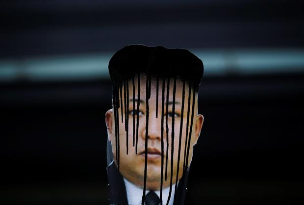 A defaced portrait of North Korean leader Kim Jong Un during an anti-North Korean rally on the 102nd birthday of North Korean founder Kim Il Sung in Seoul. Reuters/Kim Hong-Ji
