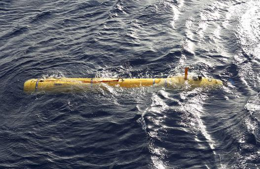 In this Monday, April 14, 2014, photo provided by the Australian Defense Force an autonomous underwater vehicle is deployed from ADV Ocean Shield in the search of the missing Malaysia Airlines Flight 370 in the southern Indian Ocean.