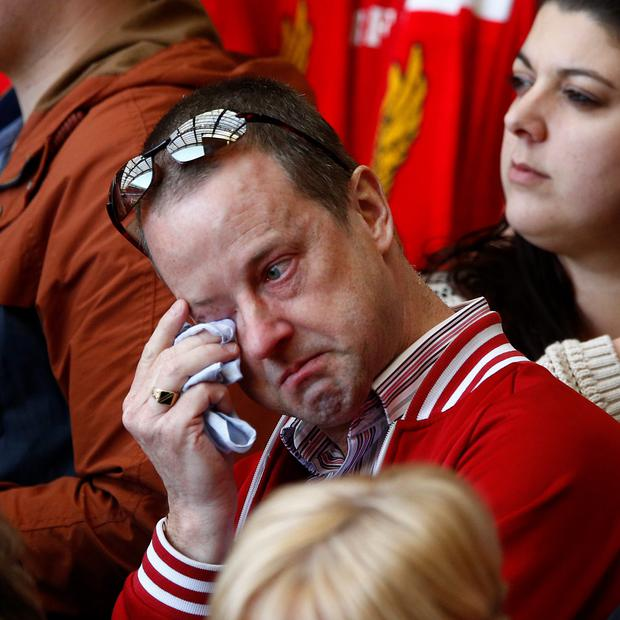A man weeps during a memorial service to mark the 25th anniversary of the Hillsborough disaster at Anfield