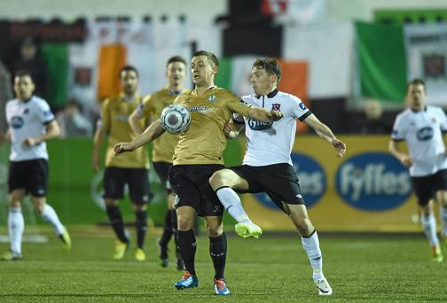 Shane Robinson, Shamrock Rovers, in action against David McMillan, Dundalk