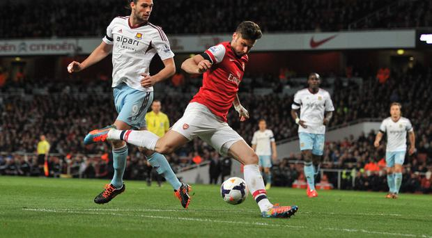 Arsenal's French striker Olivier Giroud (2-L) shoots to score a goal