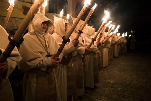 Penitents from 'Cristo de la Buena Muerte' or 'Good Dead Christ' brotherhood take part in a procession in Zamora, Spain, on the early hours of Tuesday, April 15, 2014. Hundreds of processions take place throughout Spain during the Easter Holy Week.
