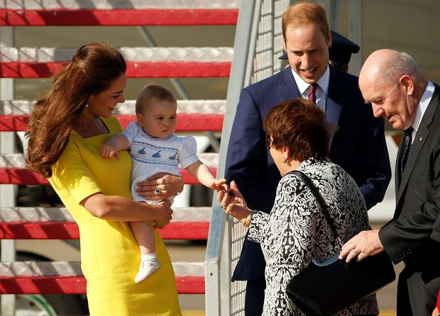 Britain's Prince William and his wife Catherine, the Duchess of Cambridge, laugh as their son Prince George shakes the hand of Lynne Cosgrove, wife of the Governor-General of Australia Peter Cosgrove, after arriving in Sydney, April 16, 2014. REUTERS/Phil Noble