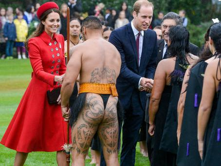 Prince William and Catherine Duchess of Cambridge talk with members of the Maori welcome group at an official welcome on the grounds of Government House in Wellington, during their 19-day trip to New Zealand and Australia