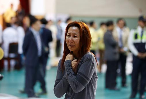 The mother of a passenger who was on a sinking ferry reacts as she finds her son at a gym where rescued passengers gather in Jindo. Photo: Reuters/Kim Hong-Ji