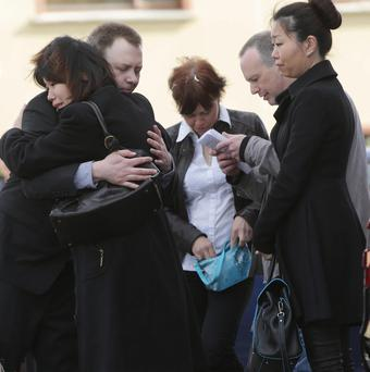 Robin Webster is comforted by family before the funeral of his wife Webster Yao at St Patricks Church Donabate. Photo: Damien Eagers