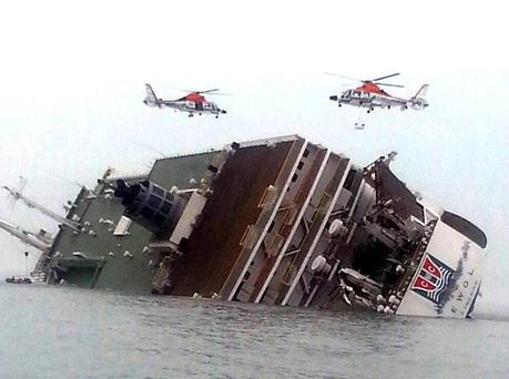 Rescue helicopters fly over a sinking South Korean passenger ferry that was carrying more than 450 passengers, mostly high school students off South Korea's southern coast. AP