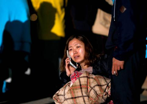 A family member of a missing passenger who was on the South Korean ferry 'Sewol' which sank in the sea off Jindo cries as she waits for a rescue team's arrival at a port in Jindo. Reuters