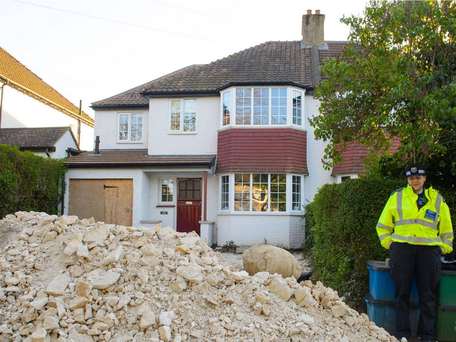 The house on Riddlesdown Road, in Purley, London where builders have uncovered human remains whilst carrying out work on the driveway