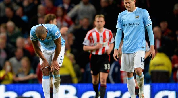 A dejected Vincent Kompany and Javi Garcia of Manchester City during the Barclays Premier League match between Manchester City and Sunderland