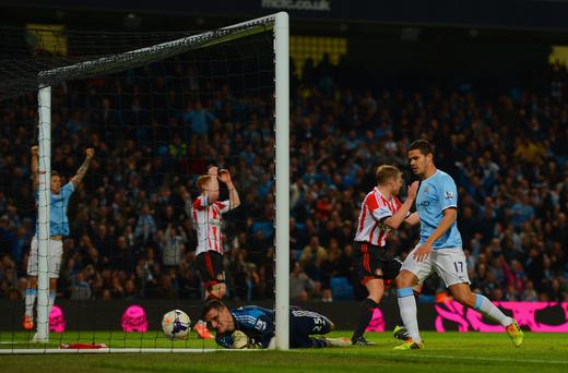 Sunderland players react as Samir Nasri of Manchester City (not pictured) effort on goal goes past Vito Mannone