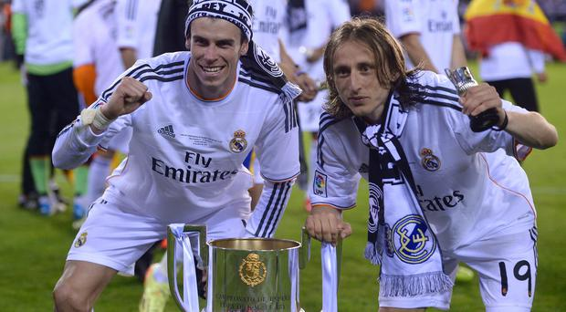 Real's Gareth Bale, left, and Luka Modric celebrate with the trophy at the end of the final of the Copa del Rey between FC Barcelona and Real Madrid last year