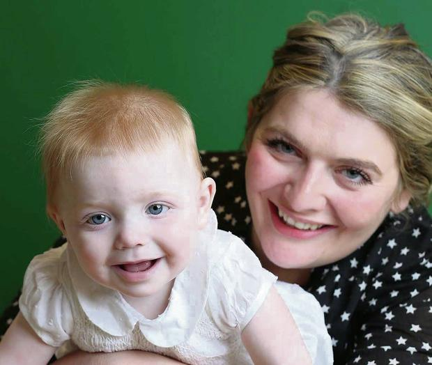 All smiles: Bryony Gordon with daughter Edie