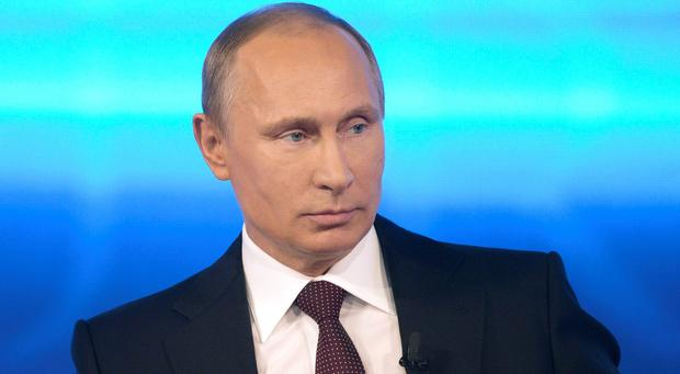Putin said Ukraine's Berkut riot police, a force disbanded by authorities in Kiev after being blamed for the deaths of protesters, had served honorably in the line of duty