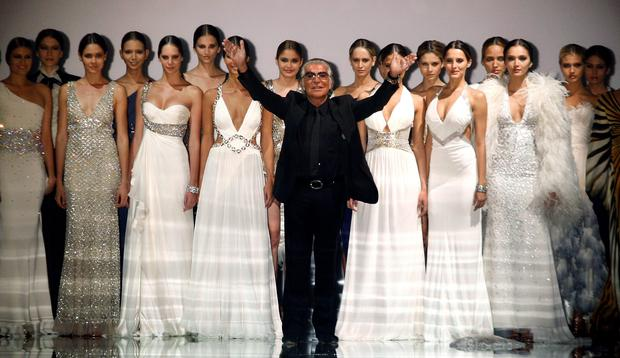 Italian designer Roberto Cavalli acknowledges the crowd after models presented his collection during the Cali Exposhow in Cali in October 20, 2010. Photo: Reuters/Jaime Saldarriaga/Files