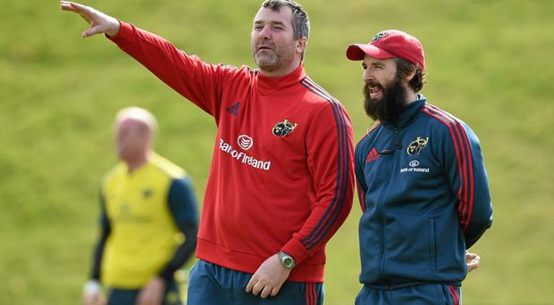 Munster forwards coach Anthony Foley, left, and strength and rehab coach Aled Walters look on during training ahead of their side's Pro12 clash against Connacht on Saturday