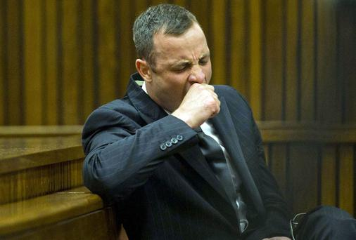Oscar Pistorius yawns as he listens to forensic evidence being given in court in Pretoria yesterday. Photo: AP