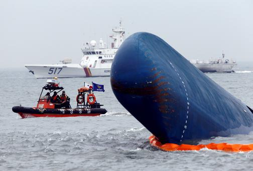 Rescue boats sail around the South Korean passenger ship 'Sewol' which sank, during their rescue operation in the sea off Jindo. Reuters