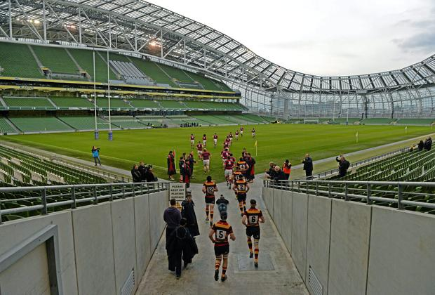 Clontarf and Lansdowne make their way onto the pitch in front of a near-empty Aviva Stadium last week for what was a crucial AIL clash. Photo: Paul Mohan / SPORTSFILE