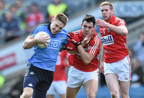 Dublin's Eoghan O'Gara attempts to get past Cork's Tom Clancy during their Allianz NFL semi-final in Croke Park. Photo: David Maher / SPORTSFILE