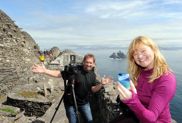 Canadian bloiggers Dave Bouskil and Dewbra Corbeilk who are travelling the Wild Atlantic Way pictured blogging from Skellig Michael on Good Friday. Picture: Don MacMonagle