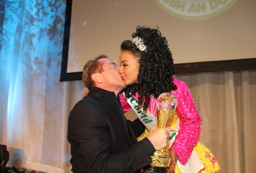 Jane Condren gets a kiss from Michael Flatley after he surprised dancers at An Comhdháil's Third World Irish Dance Championship in the INEC, Killarney