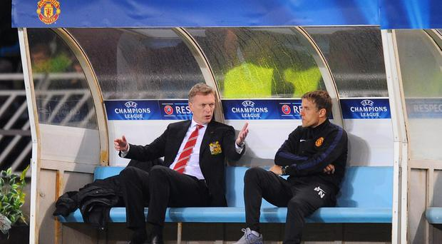 Manchester United coach Phil Neville (right) admits the failure to challenge for trophies under David Moyes has left him feeling empty. Photo by Mike Hewitt/Getty Images