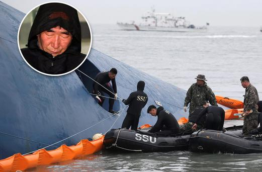 South Korean rescue team members try to rescue passengers trapped in the ferry Sewol sinking in the water off South Korea's southern coast near Jindo. Inset: Lee Joon-seok the captain of the sunken ferry, leaves a court which issued his arrest warrant in Mokpo, south of Seoul