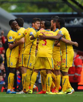 Mile Jedinak of Crystal Palace celebrates with team mates after scoring the winner from the penalty spot