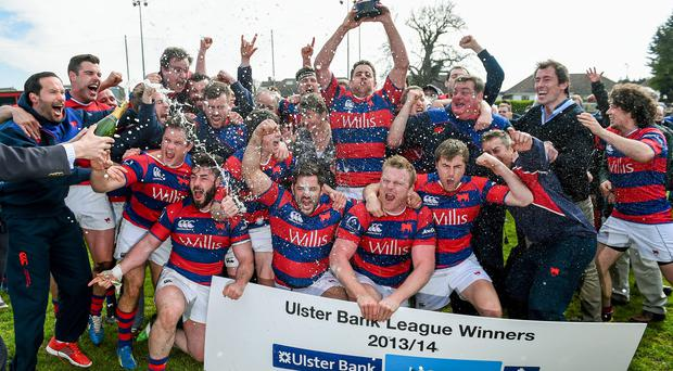 Clontarf players celebrate with the trophy after the match.