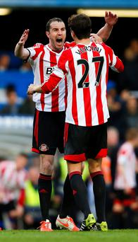Sunderland's John O'Shea and Santiago Vergini (right) react at the final whistle after the Barclays Premier League match at Stamford Bridge