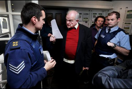 Jerry Beades remonstrates with Gardai inside Coonans Real Estate Agents on Main Street Maynooth during their protest inside the premises last February. Picture: Steve Humphreys.