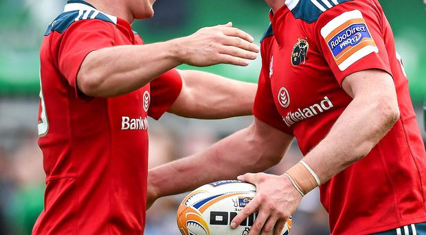 Denis Hurley, Munster, right, is congratulated by team-mate Ian Keatley after scoring his side's third try