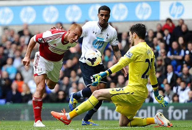 Fulham's Steve Sidwell heads the ball past Hugo Lloris of Tottenham to score his side's only goal at White Hart Lane