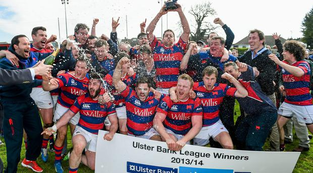 Clontarf players celebrate winning the Division 1A of the Ulster Bank All-Ireland League
