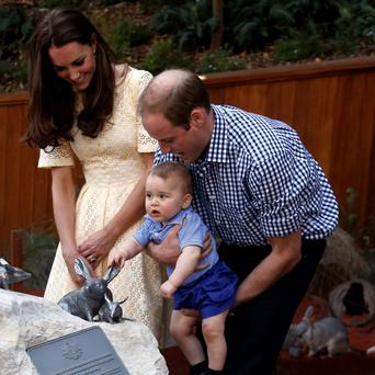 British Royals William and Kate, and Prince George reacts after they unveiled a plaque to commemorate their visit to the enclosure for the Australian animal called a Bilby during a visit to Sydney's Taronga Zoo