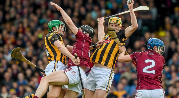 Kilkenny's John Power catches the sliotar ahead of team-mate Mark Kelly and Galway's Ronan Burke, centre, and Johnny Coen, before turning and scoring his side's crucial goal