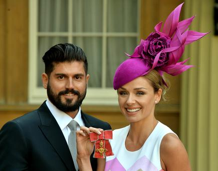 Singer Katherine Jenkins holds her OBE (Officer of the Order of the British Empire) and her partner Andrew Levitas