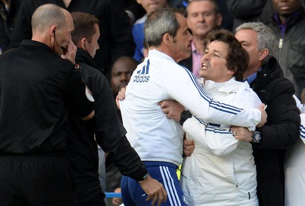 Chelsea assistant manager Rui Faria is held back by goalkeeper coach Christophe Lollichon and Jose Mourinho after being ordered off the bench by referee Mike Dean