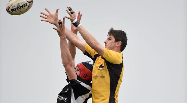 Wes Carter, Kilkenny RFC, wins possession for his side in a lineout ahead of James Rooney, Ashbourne RFC